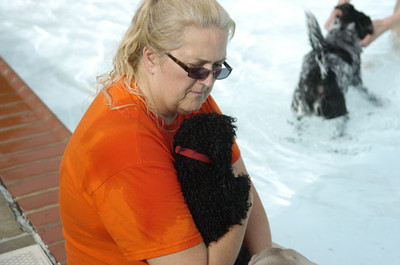 Paula Gustafson of Lewisburg holds her dog pepper at the Lewisburg Community Pool on Tuesday.
