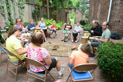 Kids and adults play away at a drum circle on Tuesday at the Packwood House in Lewisburg lead by Steve Mitchell.