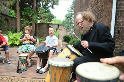 Wyatt Adams, 8, left, and Ian Everhart, 9, play their instruments next to Steve Mitchell as he leads a drum circle at the Packwood House in Lewisburg on Tuesday.