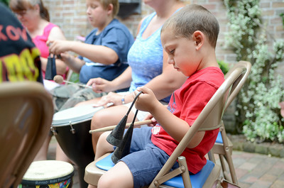 Quinn Everhart, 4, bangs on his instrument Tuesday morning during a drum circle at the Packwood House in Lewisburg.