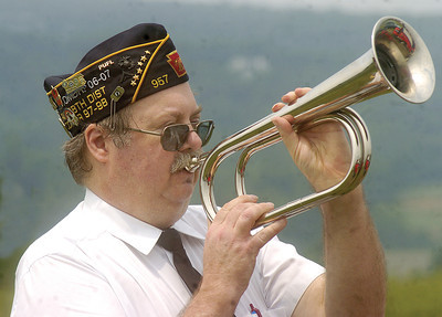 Henry Halvorsen plays taps during the Memorial Day ceremony at Dry Valley Cemetery on Sunday.