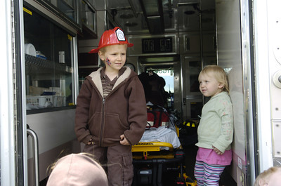 Lee Myers, 5, left, and his sister Octavia Myers, 2, Dornsife, check out the back of the Montgomery Volunter Fire Company's ambulance on Wednesday at the Emergency Preparedness Day at the FCC Allenwood Training Center.