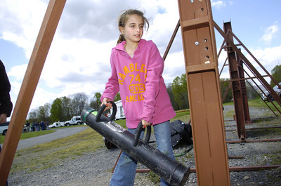 Ashlyn Maris, 9, Hughesville, tries to knock in a door on Wednesday using a battering ram at the Emergency Preparedness Day at the FCC Allenwood Training Center.