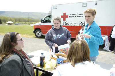 Transitions employees Tara, bottom left, and Alesha, bottom right, talk with Tracy Jones, Sunbury, and Jami Vankirk, Sunbury, on Wednesday at the Emergency Preparedness Day at FCC Allenwood Training Center.