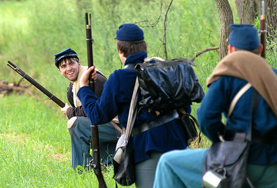 Cody Dillman of Middleburg shares his plans to flank the enemy with fellow members of the 151st Pa. Infantry Co. D during the battle Saturday at the Civil War reenactment in Hartleton.