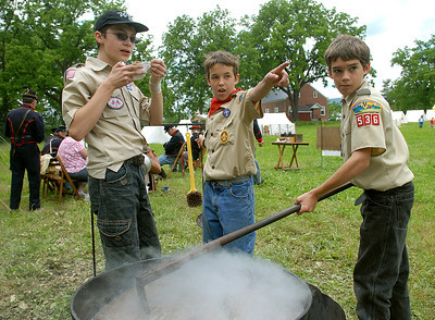 Noah Snare, 12 of Millmont, left, and brothers, Paul, 12, and John Hughes, 11, of Hartleton, spot the enemy as they take up the call to care for the bean soup during a Civil War reenactment in Hartleton Saturday June 2, 2012.
