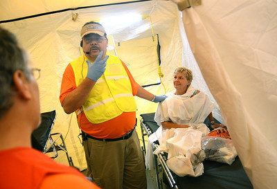 "Harriet Botdorf of McClure listens as Tom Grace, the SEPA SMART team leader, gives direction for her discharge after a hazardous material and mass casualty exercise at Evangelical Community Hospital Tuesday Aug. 21, 2012.  Botdorf joined dozens of volunteer ""vicitims"" in a scenario giving emergency personnel the opportunity to practice de-contamination, triaging, patient tracking and setting up a intensive car unit."