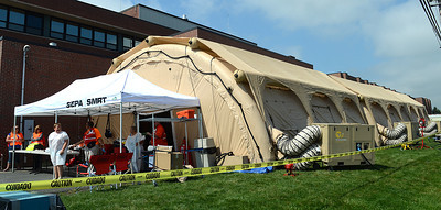 Volunteer victims leave the inflateable shelter after helping with the hazardous material and mass casualty exercise at Evangelical Community Hospital Tuesday Aug. 21, 2012.  Dozens of vicitims and emergency responders came together in a scenario giving the emergency personnel the opportunity to practice de-contamination, triaging, patient tracking and setting up a intensive car unit.
