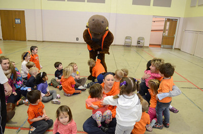 Bucky Bison gets greeted by a group of preschoolers from the Kids of the Kingdom Preschool in Lewisburg on Friday for the school's sports day.