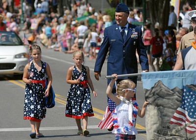 Maggie, 8, left, and Millie Gelnett, 5, walk with their grandfather, Donald Koch, all of Watsontown in Lewisburg's 4th of July Parade Saturday June 30, 2012.