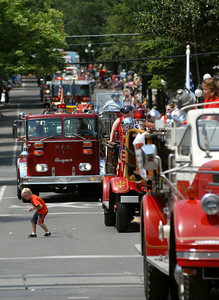 Candy is collected as fire trucks from around the area finis Lewisburg's 4th of July Parade Saturday June 30, 2012.