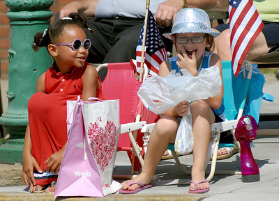 Friends, Jolyce Snyder, 5, of New Columbia and Sydney Herbst, 6, of Winfield keep an eye out for candy at Lewisburg's 4th of July Parade Saturday June 30, 2012.