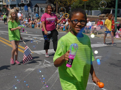 Zahki Nettles, 9, of Lewisburg shares bubbles with the spectators lining Market Street during Lewisburg's 4th of July Parade Saturday June 30, 2012.