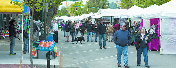Patrons walk along Market Street and browse vendors' goods at the Lewisburg Arts Festival on Saturday.