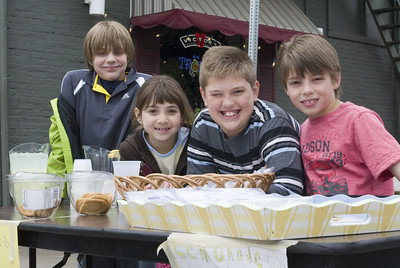 From left: Evan Dominick, Madison Dominick, Brendan Fisher, and Ethan Dominick work at a lemonade stand during the Lewisburg Arts Festival on Saturday.
