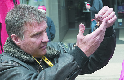 Brian Mariano of Bloomsburg creates jewelry at the Lewisburg Arts Festival on Saturday.