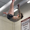 Lewisburg's Erik Temple flies through the air during diving practice at Susquehana University on Thursday.