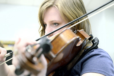 Broghan Hoffman-Aho, 16, practices her violin during a lesson on Wednesday morning at Lewisburg High School.