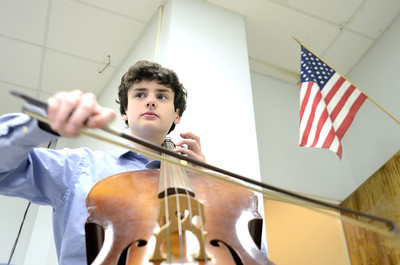 Lewisburg High School freshman Matthew Benjamin, 15, plays the cello during a lesson on Wednesday morning.