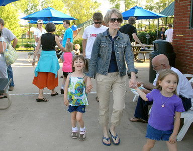 Twins, Katie, left, and Lauren Boop, 5, of Middleburg arrive with friend, Rebecca Brown, at the Lewisburg pool open house Friday May 18, 2012.