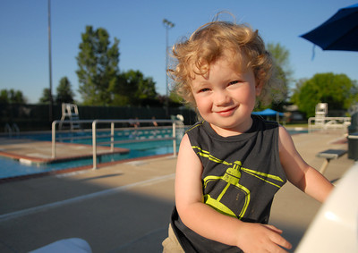Wyatt Searles, 2, of Lewisburg claims his seat next to the pool Friday night at Lewisburg Pool's open house.