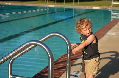 Wyatt Searles, 2, of Lewisburg can't wait for the pool to open and tries to sneak during the Lewisburg Pool's open house Friday May 18, 2012.