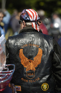 Clayton Winters, Strasburg, proudly wears his American flag bandanna Friday morning during the annual May Day ride at the Country Cupboard in Lewisburg.
