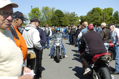 Motorcycle riders stop for a second to talk as they come and go from the annual May Day ride at the Country Cupboard in Lewisburg on Friday morning.