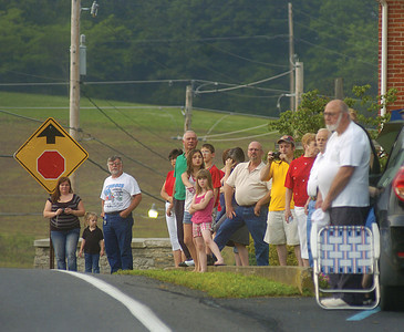 Spectators line the road during the Memorial Day parade in Mazeppa on Sunday.