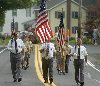 Veterans followed by boyscouts walk down Johnson Mill Road during the Memorial Day parade in Mazeppa on Sunday.