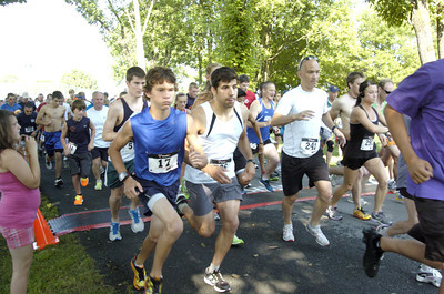 Runners take off at the start of Wednesday's Mifflinburg 5k race.