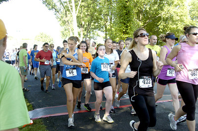 Racers cross the starting line on their way toward the finish line at the Mifflinburg 5k on Wednesday.