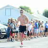 Vince Fadale of Selinsgrove cruises to the finish line in first place during Friday's Mifflinburg 5k race.