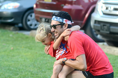 Baylee Wetzel, 6, Lewisburg, gives Michael Espinosa, Lewisburg, a good luck hug before the start of the Mifflinburg 5k race on Friday.
