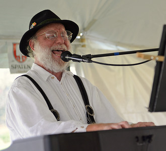 "Co-Coordinator of the Mifflinburg Oktoberfest Larry Michaels, plays the keyboard as the ""One Man German Band"" on Friday afternoon on Route 45."