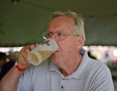 Jerry Bottiger, of Mifflinburg, enjoys a beer at the Mifflinburg Oktoberfest on Friday afternoon on Route 45. Oktoberfest continues from 11 am to 10 pm today.