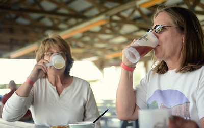 Sharon DiMichele, of Trout Run, and Linda Sheats, of Pottsgrove, enjoy their beers on Friday afternoon.