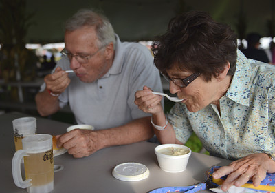 Jerry and Anita Bottiger, of Mifflinburg, enjoy cups of asparagus and crab soup at the Mifflinburg Oktoberfest on Friday afternoon.