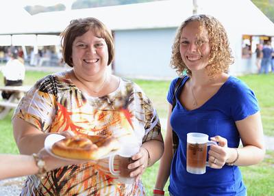 Dawn and Kelsey Benner, of Mifflinburg, pose with their pretzel at Mifflinburg Oktoberfest on Friday afternoon.