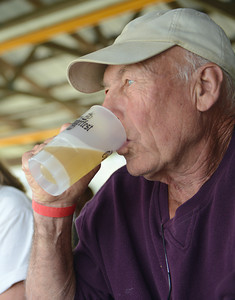 Barry Shipman, of Trout Run, drinks a beer at Miffilnburg Oktoberfest on Friday afternoon.