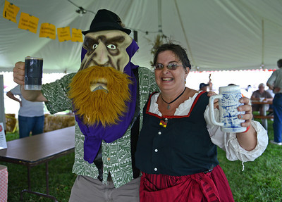 Greg Ryan, of Milwaukee, and Leanna Bechdel, of Mifflinburg, pose together at the Mifflinburg Oktoberfest on Friday afternoon.
