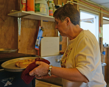 Paula Christy, of Mifflinburg, heats up a pretzel.