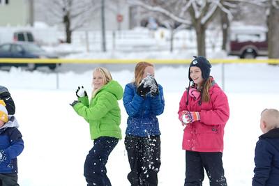 Ella Shuck, 9, left, Mifflinburg, Remi Stahl, 10, Mifflinburg, and Kira Hackenberg, 11, Mifflinburg laugh while having fun at a snowball throwing contest in Mifflinburg on Thursday.