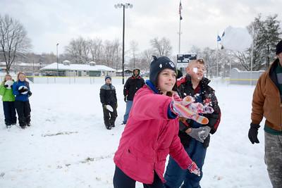 Kira Hackenberg, 11, left, Mifflinburg, throws a snowball while competing with Jadynn Miller, 11, Mifflinburg, at an impromptu snowball throwing contest in Mifflinburg on Thursday afternoon.