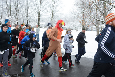 Jason Rippon paces the pack while wearing the traditioinal turkey outfit at Thursday's annual Turkey Trot 5k in Mifflinburg.