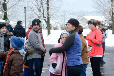Ruth Wilson, 12, left, Ohio, keeps warm with her aunt, Kelly Valentine, Baltimore, before the start of Thursday's annual Turkey Trot 5k in Mifflinburg.