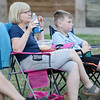 Robert Inglis/The Daily Item  Kathy Dadalt and her son Ben take in Jaws at Hufnagle Park in Lewisburg during a showing by the Campus Theater.