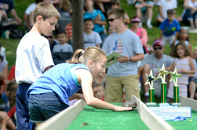 Fallon Snook, 10, New Berlin, cheers on her turtle End Dive at the annual Turtle Derby in New Berlin on Friday.