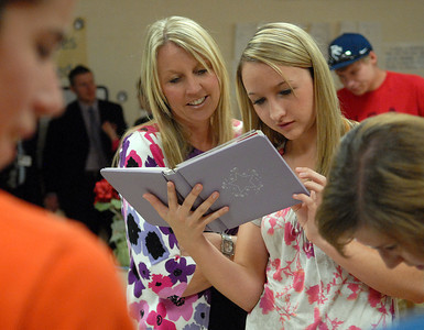 Kelly Erb, left, and her daughter, Alexis, 15, look through photos of students from past years at New Berlin Elementary School's open house Thursday May 17, 2012.