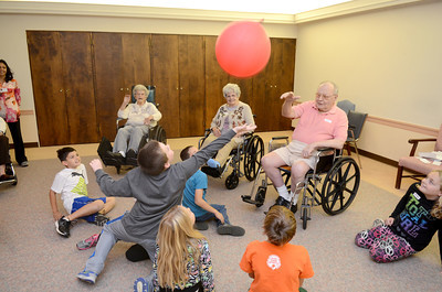 Lewisburg Elementary third grade students from Mrs. Megan Germ's class play with seniors at Riverwoods on Wednesday morning.